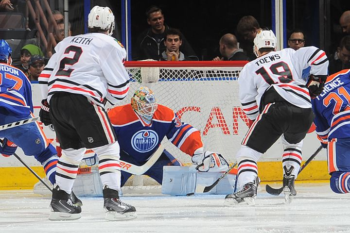 Ben Scrivens #30 of the Edmonton Oilers makes a save on a shot from Jonathan Toews #19 of the Chicago Blackhawks on November 22, 2014 at Rexall Place in Edmonton, Alberta, Canada.