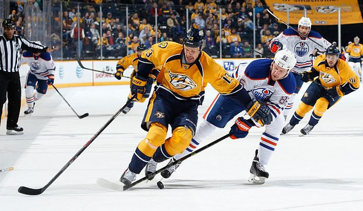 Olli Jokinen #13 of the Nashville Predators skates against Nikita Nikitin #86 of the Edmonton Oilers at Bridgestone Arena on November 27, 2014 in Nashville, Tennessee.