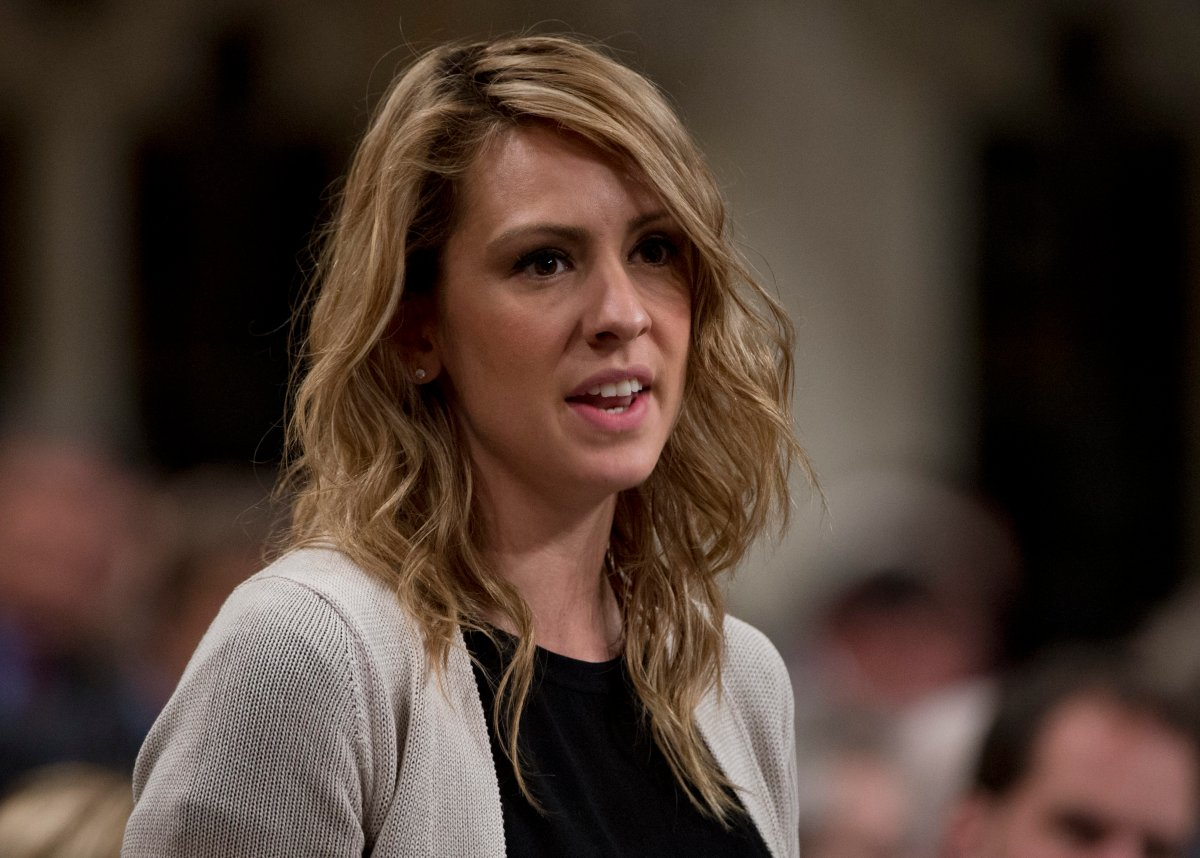 NDP MP Ruth Ellen Brosseau rises in the House of Commons in Ottawa, Tuesday October 16, 2012. THE CANADIAN PRESS IMAGES/Adrian Wyld.