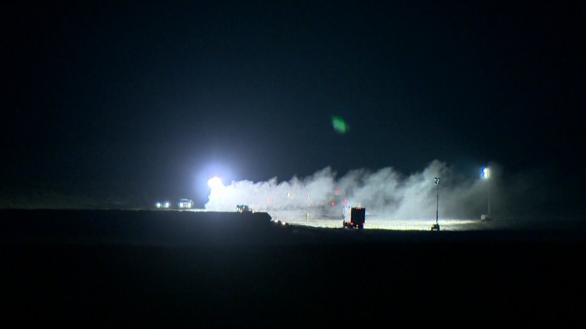 Crews work to cap sour gas well southwest of Airdrie.