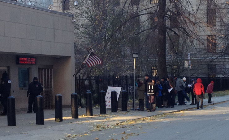 People wait in line outside the U.S. consulate in Toronto on November 14, 2014.