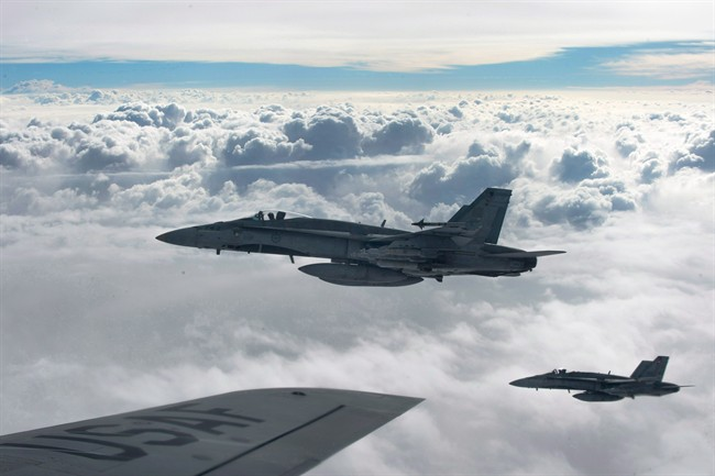 Royal Canadian Air Force CF-18 Hornets, above, in October 2014, over Iraq.