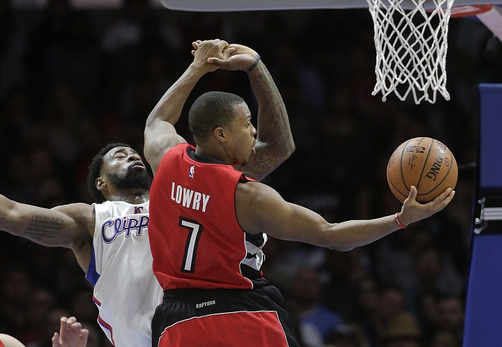Toronto Raptors' Kyle Lowry, right, goes up for a basket as Los Angeles Clippers' DeAndre Jordan defends during the first half of an NBA basketball game Saturday, Dec. 27, 2014, in Los Angeles.