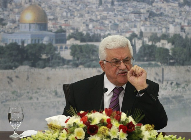 In this file photo taken Saturday, Jan. 11, 2014, Palestinian President Mahmoud Abbas speaks during a meeting at his compound in the West Bank city of Ramallah.