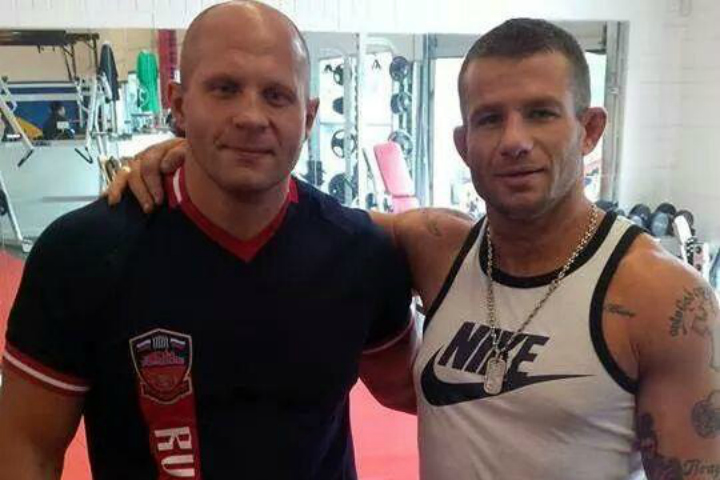 Ryan Chiappe (right), seen here posing with MMA legend Fedor Emelianenko, faces several criminal charges.