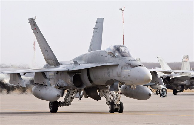 A pilot positions a CF-18 Hornet at the CFB Cold Lake, in Cold Lake, Alberta on Tuesday, October 21, 2014.