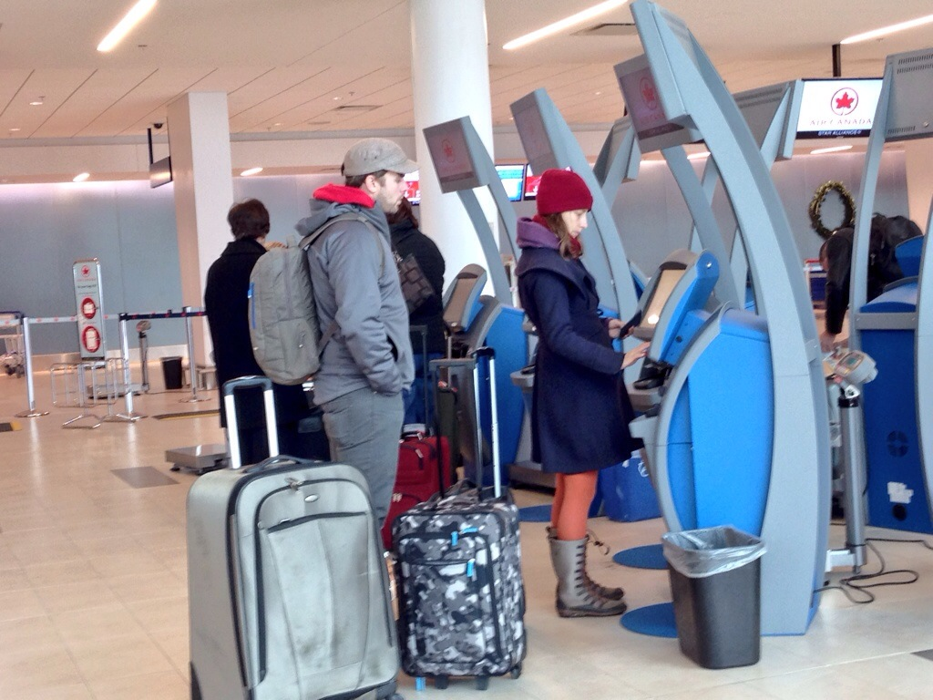 Travelers check in at the Halifax Stanfield International Airport.