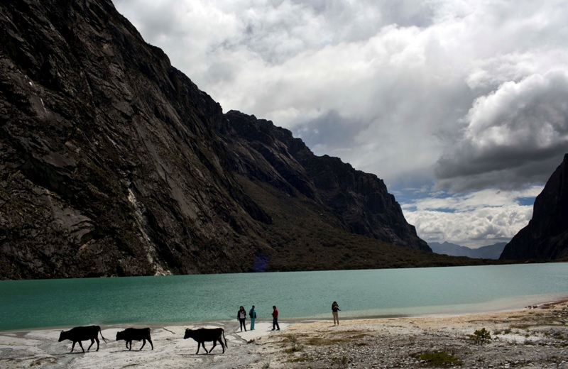 People gather near the Chinamacocha lake in the Huascaran National Park in Huaraz, Peru, Tuesday, Dec. 2, 2014. Glaciers have lost more one-fifth of their mass in just three decades, and the 70 percent Peru's 30 million people who inhabit the country's Pacific coastal desert, depend on glacial runoff for hydropower and to irrigate crops, meaning their electricity and long-term food security could also be in peril.