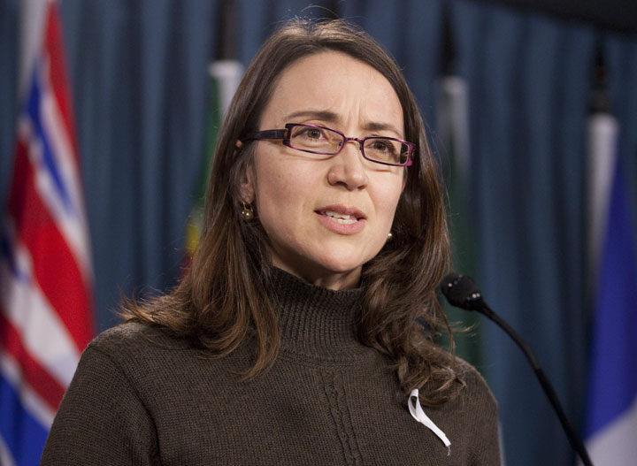 Nathalie Provost, a victim of the 1989 shooting at Ecole Polytechnique in Montreal, speaks about gun control during a news conference on Parliament Hill in Ottawa, Thursday November 24, 2011.