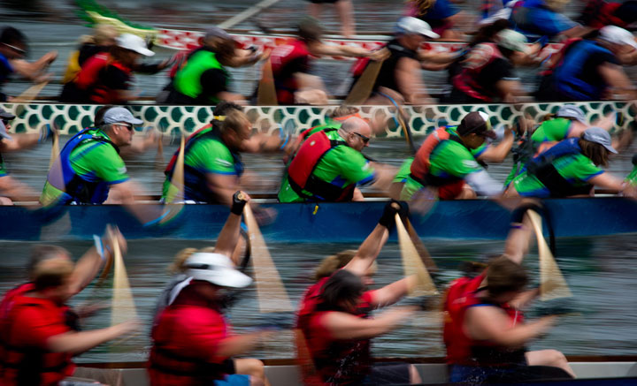 Competitors race during the Rio Tinto Alcan Dragon Boat Festival on False Creek in Vancouver, B.C., on Sunday June 22, 2014.