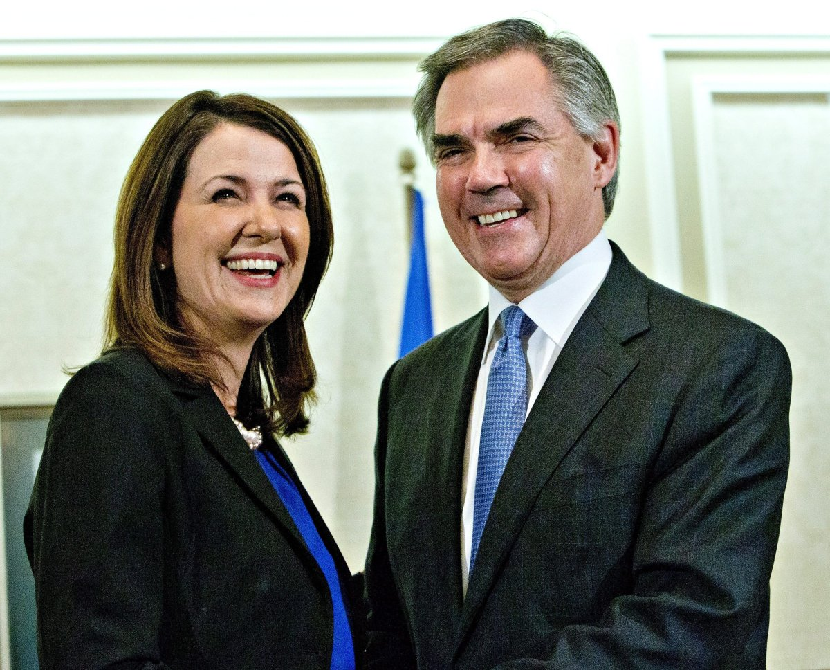 Alberta Premier Jim Prentice and former Wildrose Leader Danielle Smith speak to media after a caucus meeting in Edmonton Alta., Wednesday, December 17, 2014. Prentice's caucus met to discuss a bid by at least half the official Opposition to cross the floor.
