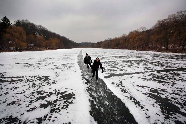 A couple skates along a path in the snow on Grenadier Pond in Toronto's High Park on December 29, 2010. Plunging temperatures will soon make way for frozen-over waterways and community rinks, giving skating enthusiasts a chance to lace 'em up for another season.