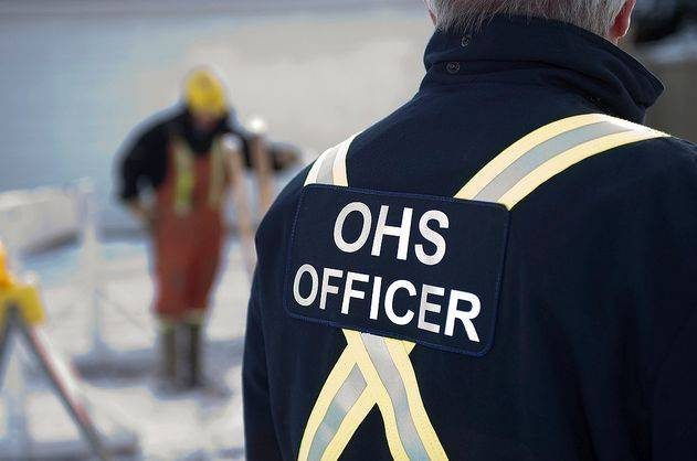 A man in his thirties is Alberta Occupational Health and Safety Officer.