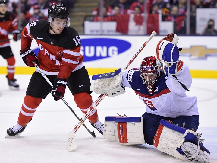 Canada's Max Domi (16) tries to get one past Slovakia's Denis Godla during second period semifinal hockey action at the IIHF World Junior Championship in Toronto on Sunday, Jan. 4, 2015.