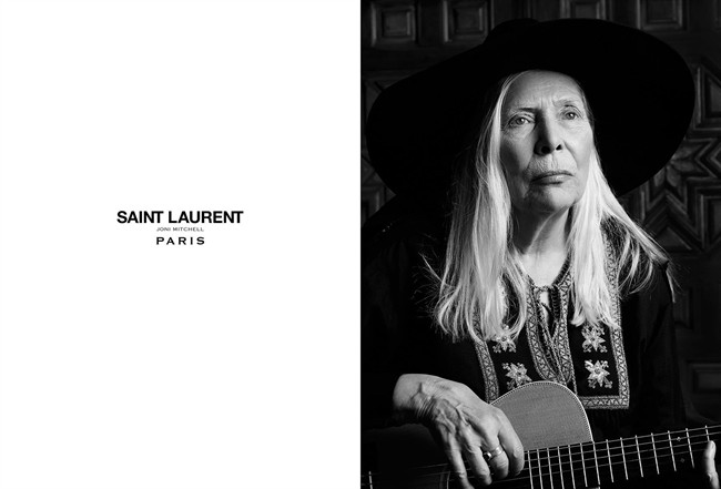 Joni Mitchell wears an Yves Saint Laurent folk tunic, a leather cape by designer Hedi Slimane and the Yves Saint Laurent classic fedora in this undated handout photo taken in Bel Air, California. Mitchell and Joan Didion are well into their golden years, but the music icon and literary legend have emerged as fashion's freshest faces.