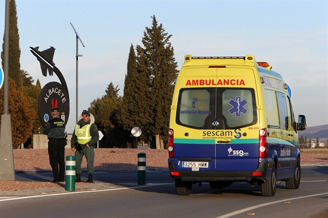An ambulance drives past one of the entrances of a military base after a plane crash in Albacete, Spain, Monday, Jan. 26, 2015. (AP Photo/Josema Moreno).