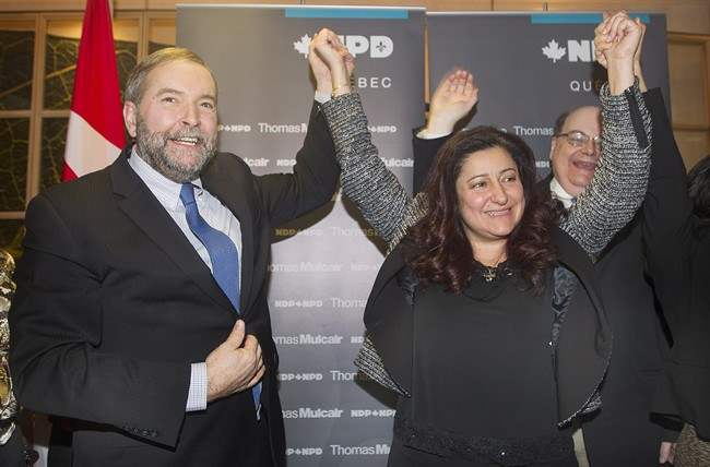 NDP leader Thomas Mulcair raises the hand of Maria Mourani in Montreal, Wednesday, January 21, 2015, where he announced that she would run as an NDP candidate in the riding of Ahuntsic-Cartierville in the upcoming federal election.