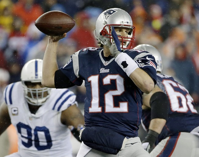 New England Patriots quarterback Tom Brady looks to pass during the first half of the NFL football AFC Championship game against the Indianapolis Colts in Foxborough, Mass. on Jan. 18, 2015.