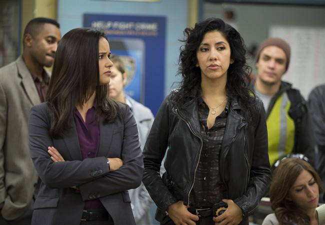 """In this image released by Fox, Melissa Fumero, left, and Stephanie Beatriz appear in a scene from the comedy series, """"Brooklyn Nine-Nine.""""."""