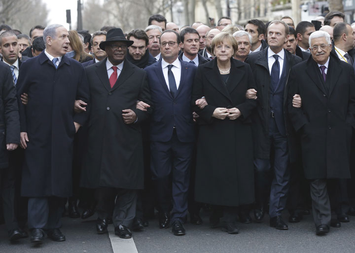 From the left, Israeli Prime Minister Benjamin Netanyahu, Malian President Ibrahim Boubacar Keita, French President Francois Hollande, German Chancellor Angela Merkel, EU president Donald Tusk and Palestinian Authority President Mahmoud Abbas march during a rally in Paris, France, Sunday, Jan. 11, 2015.