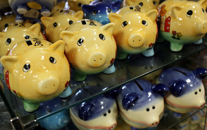 Piggy banks sit on a shelf