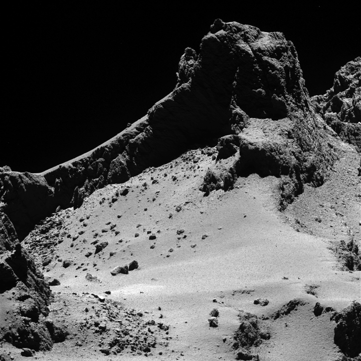 A section of the smaller of Comet 67P/Churyumov–Gerasimenko's two lobes as seen through Rosetta's narrow-angle camera from a distance of about 8 km to the surface on 14 October 2014.