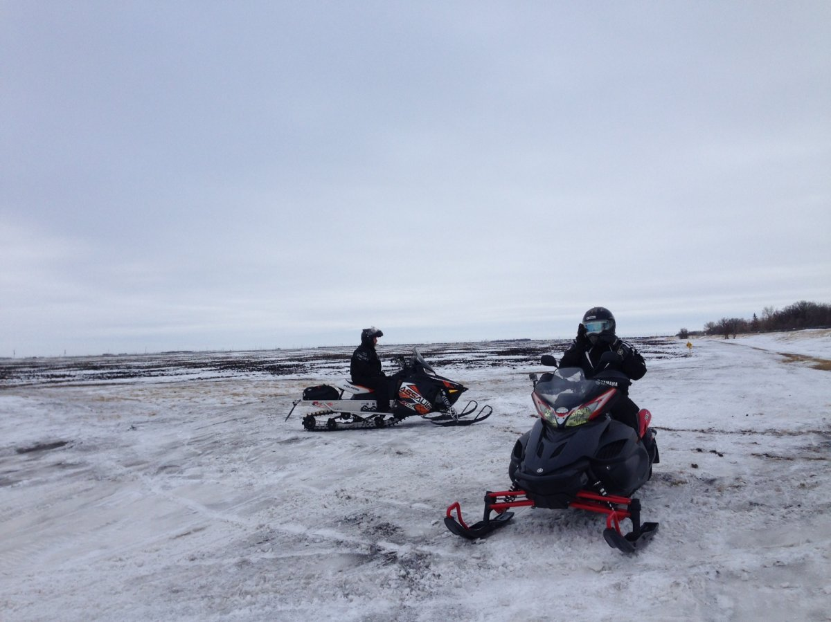 Trails for snowmobiles are mostly grass and dirt due to the warmer weather.