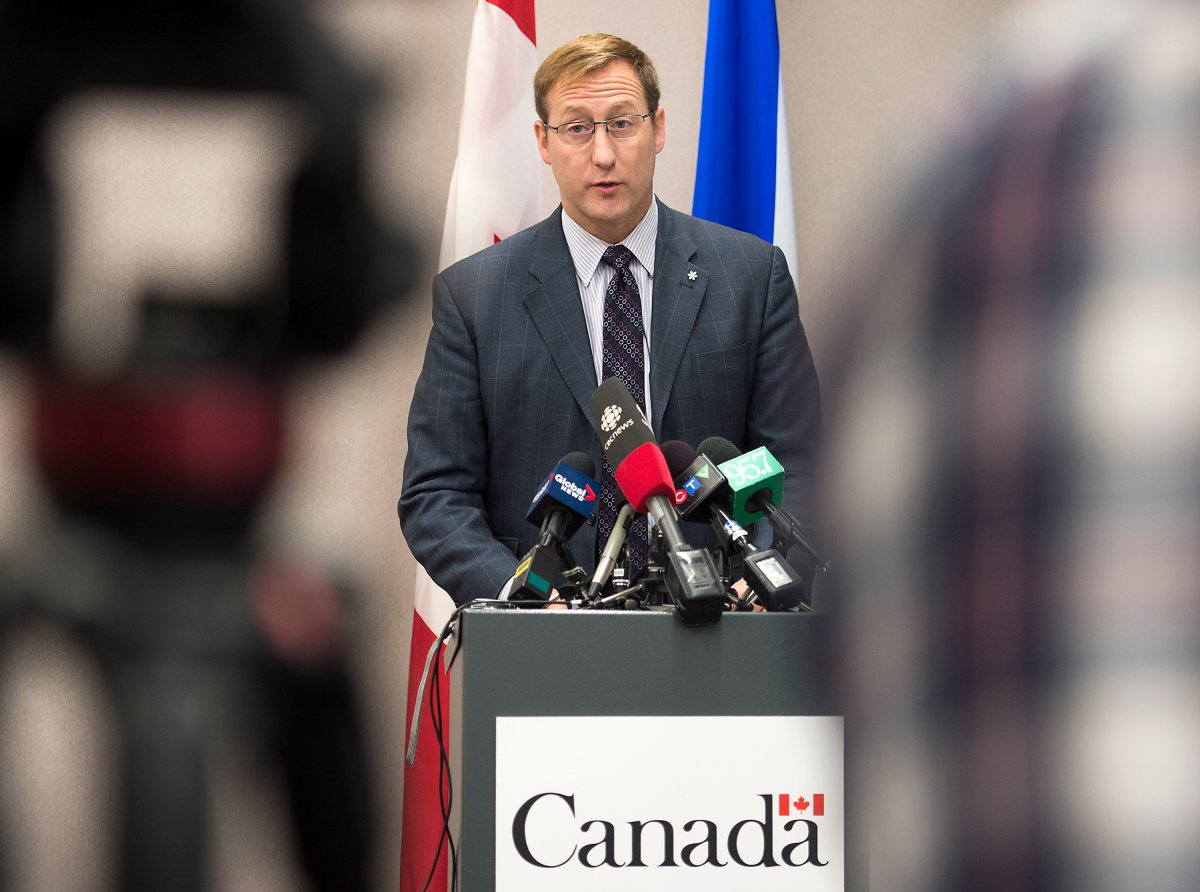 Justice Minister Peter MacKay addresses a news conference, regarding a foiled mass murder plan, in Halifax on Saturday, Feb. 14, 2015. MacKay said the plot to carry out the killings in a public place was not linked to terrorism.