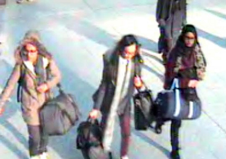 This is  a still taken from CCTV issued by the Metropolitan Police in London on Monday Feb. 22, 2015,  of 15-year-old Amira Abase, left,  Kadiza Sultana,16, centre, and Shamima Begum,15 going through Gatwick airport, before they caught their flight to Turkey on Tuesday Feb 17, 2015. The three teenage girls  left the country in a suspected bid to travel to Syria to join the Islamic State extremist group.