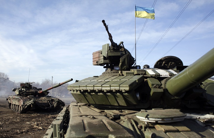 Ukrainian army tanks ride through a checkpoint near Horlivka, in the region of Donetsk, on February 23, 2015.
