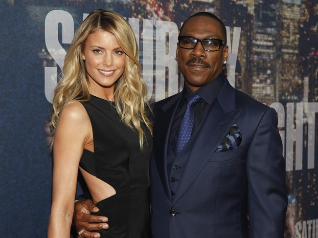 Paige Butcher, left, and Eddie Murphy attend the SNL 40th Anniversary Special at Rockefeller Plaza in New York on Feb. 15, 2015.