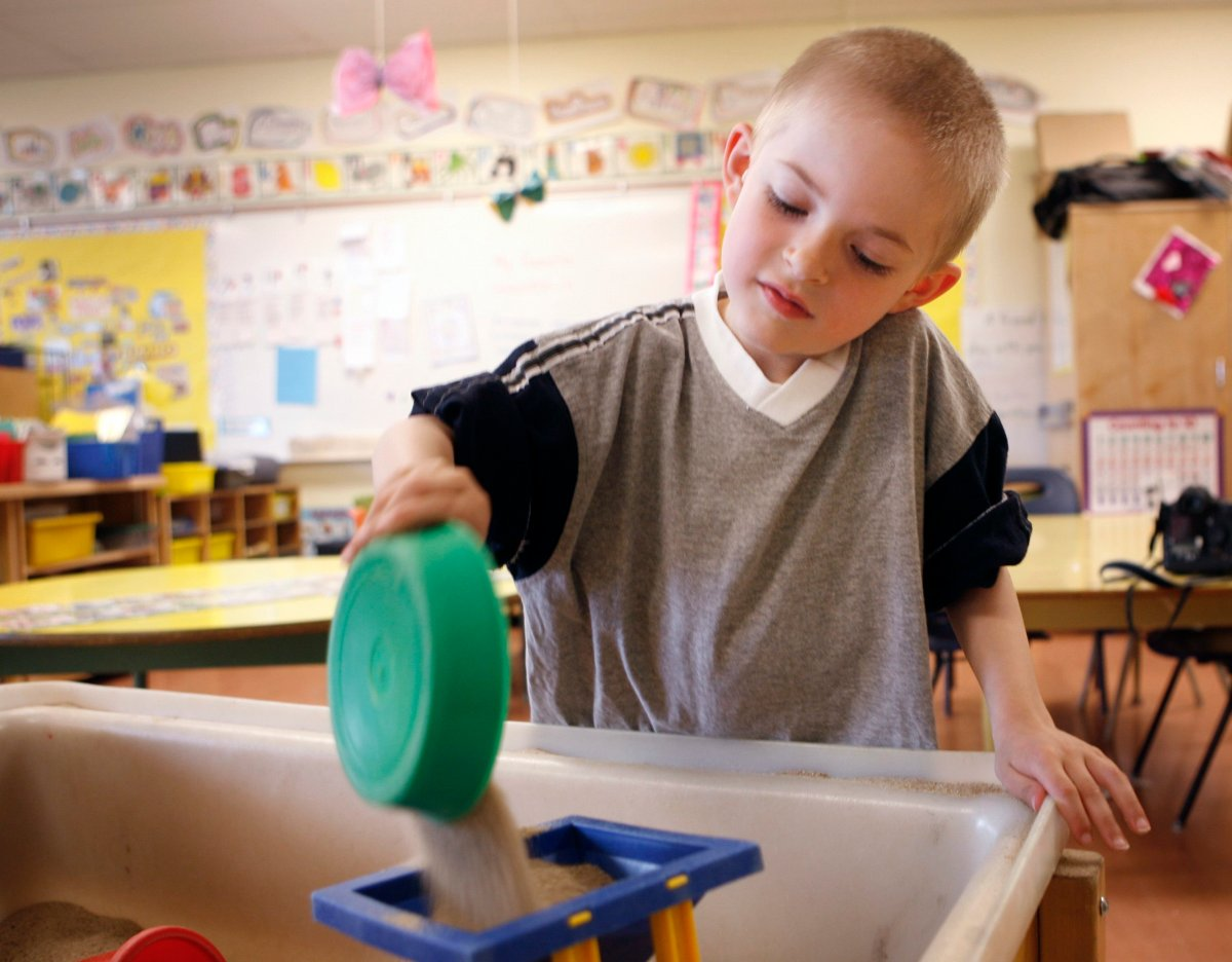 Cole Mercier, six, plays in his all-day kindergarten class in Calgary, Monday, June 15, 2009.