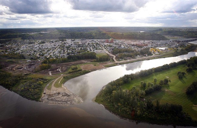 The city at the heart of Canada's oilsands is no ghost town, but things have slowed down a bit in Fort McMurray, Alta. An aerial view of Fort McMurray is shown in this Monday, Sept. 19, 2011 photo. THE CANADIAN PRESS/Jeff McIntosh.
