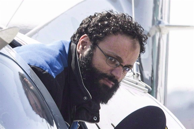 Chiheb Esseghaier, accused of plotting a terror attack on a rail target, is led off a plane by an RCMP officer at Buttonville Airport, just north of Toronto, on Tuesday, April 23, 2013.