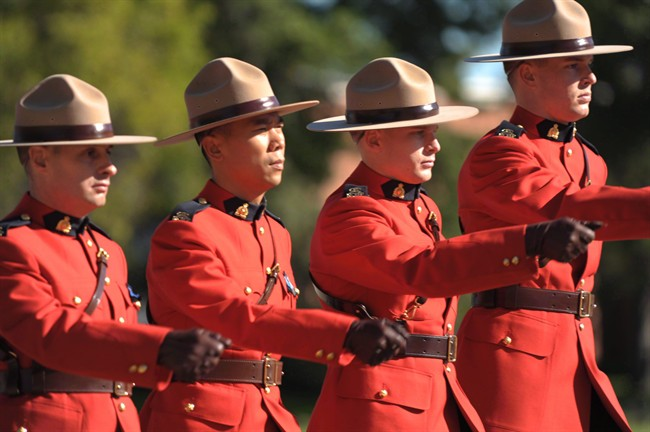RCMP officers march off the parade grounds following the RCMP National Memorial Service in Regina Sunday, September 12, 2010.