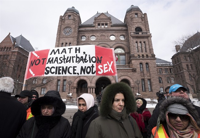 Demonstrators gather in front of Queen's Park to protest against Ontario's new sex education curriculum in Toronto on Tuesday, February 24, 2015.