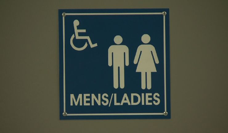 In this file photo a sign shows a gender-neutral washroom. Advocates are pushing for more gender-neutral bathrooms in Quebec schools. Thursday, Feb. 2, 2017.