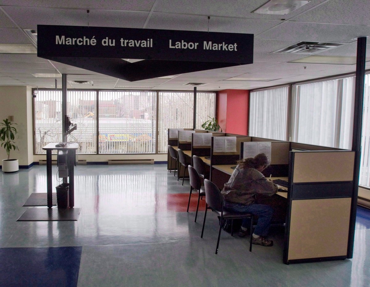 A man looks through jobs at a Resource Canada office in Montreal.