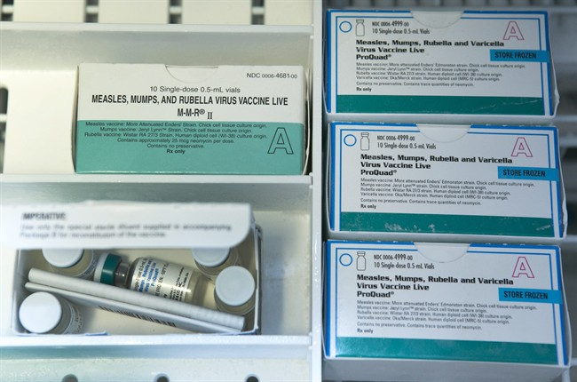 This Thursday, Jan. 29, 2015 file photo shows boxes of the measles, mumps and rubella virus vaccine (MMR) and measles, mumps, rubella and varicella vaccine inside a freezer at a doctor's office in Northridge, Calif.