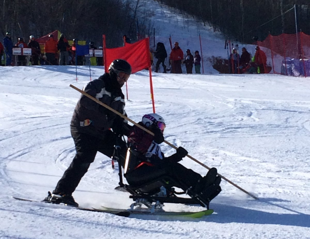 Skylar Derin uses a sit and ski to ride down the  hill at Mission Ridge Winter Park.