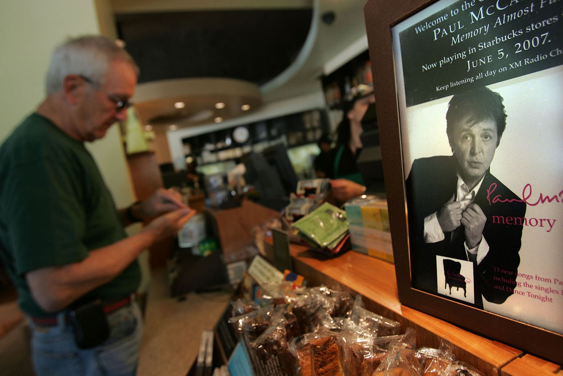 An advertisements for the Paul McCartney CD album 'Memory Almost Full' at a Starbucks store in 2007. Starbucks will end compact disc sales next month.