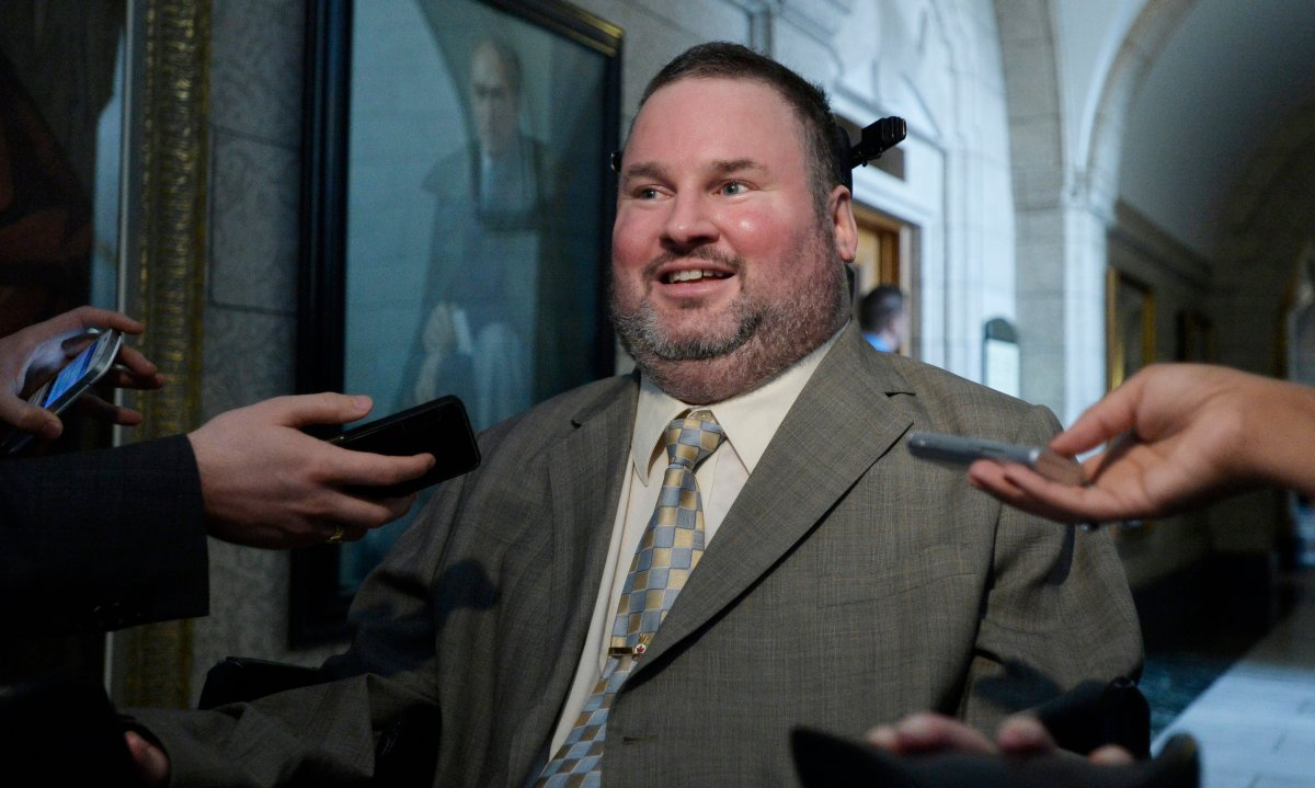 Conservative MP Steven Fletcher scrums with media in Ottawa on Wednesday, February 25, 2015. THE CANADIAN PRESS IMAGES/Matthew Usherwood.
