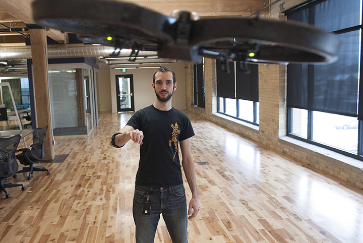 Mark DiFranco, a software engineer, uses a Myo gesture control armband to fly a drone at the Thalmic Labs headquarters in Kitchener on Thursday, December 11, 2014.