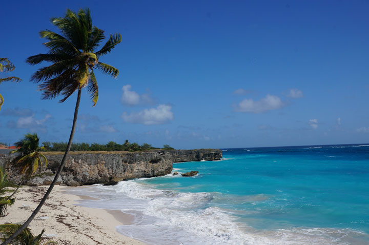 This January 2015 photo shows Bottom Bay in Barbados. The Caribbean island is relatively easy on the wallet, with easy-to-use public vans to beaches around the island, plus dining options like Oistins Fish Fry, an outdoor bazaar of restaurant shacks serving heaping plates of food.