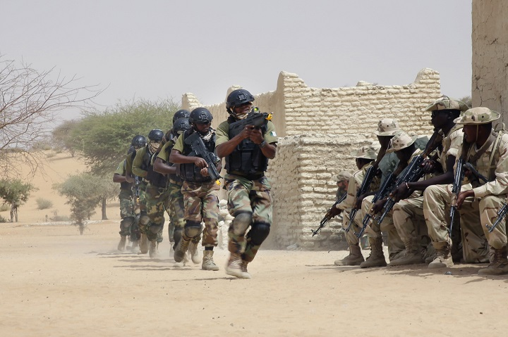 Nigerian special forces run past Chadian troops in an hostage rescue exercise at the end of the Flintlock exercise in Mao, Chad, Saturday, March 7, 2015. The U.S. military and its Western partners conduct this training annually and set up plans long before Boko Haram began attacking its neighbors Niger, Chad and Cameroon.