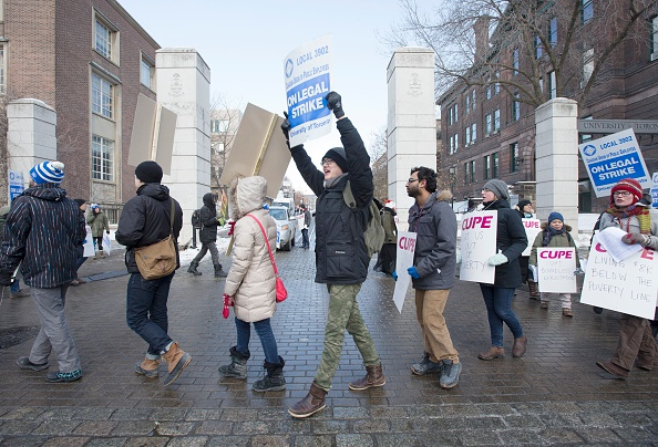 Picketers from CUPE 3092, representing teaching assistants, began their strike in front of gate to campus on King's College Rd. and College Street on March 2, 2015.