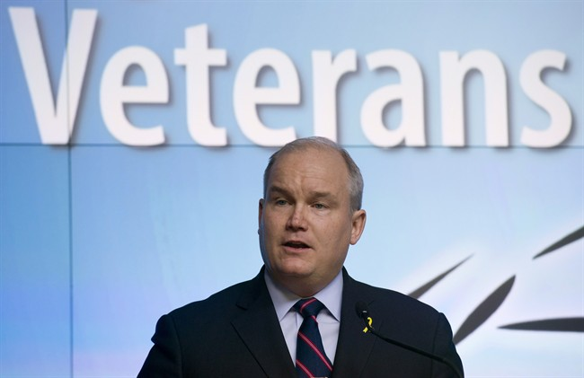 Minister of Veterans Affairs Erin O'Toole speaks during a news conference at the Department of National Defence headquarters in Ottawa on Monday March 30, 2015.