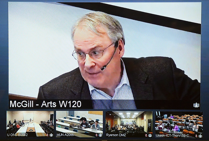 Ken Dryden is seen on a video screen at Ryerson University while leading a class via webcam from McGill University in Montreal on Thursday, March 26, 2015.