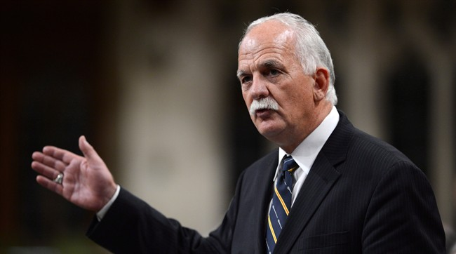 Vic Toews, seen here in 2013, is challenging a conflict of interest ruling against him in federal court.