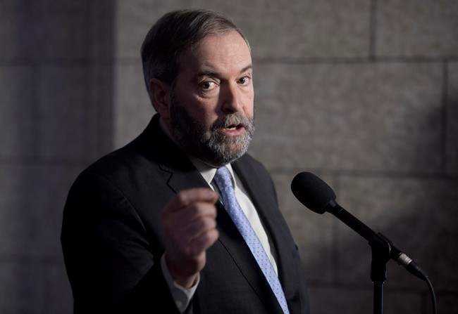 NDP Leader Tom Mulcair speaks with the media following caucus in Ottawa on March 25, 2015. Tom Mulcair says an NDP government would take tax benefits from those who need them least and give them to those who need them most.